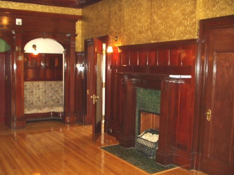 Millwork connects rooms.Lougheed House in Calgary.