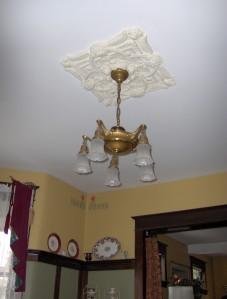 Pan chandelier with original plaster medallion.