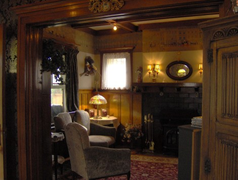 A warm and cosy parlour made even warmer with incandescent bulbs. Twin Gables, Calgary Alberta