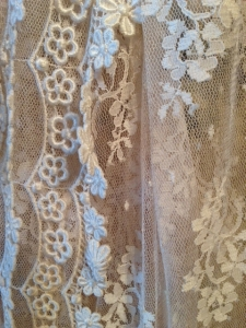 Detail of machine made lace on a 1930 flapper dress