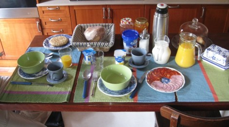 A Spanish breakfast with potato omelette, cold cuts, and rustic bread