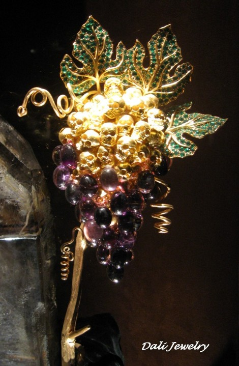 A Close up of one of the more sculptural pieces showing grapes. Amethyst, emeralds, gold and more.