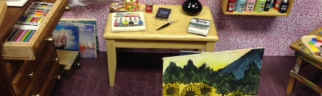 I love this one. Note the tubes of paints, paint brushes and tiny paintings.