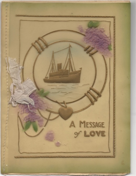 Although this card looks a lot like a Valentine, it is actually a Christmas card.