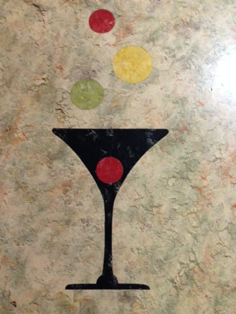 This martini pattern was repeated several times on the floor of the basement's 'rumpus' room.s