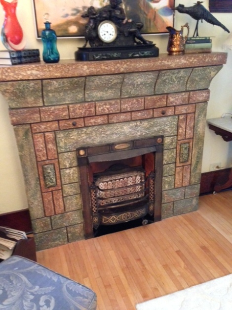 Our 1927 concrete fireplace with its original insert.
