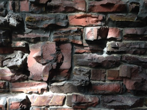 A detail of the exterior wall showing unique combinations of clinker bricks