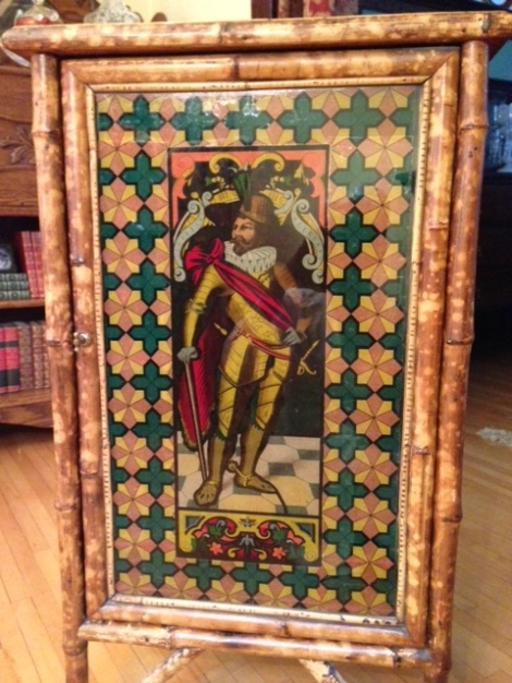 The glass door is faced with a lithograph of an Elizabethan gentleman