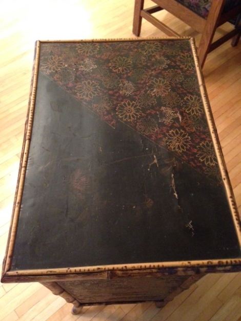 Note the black lacquer top with asymmetrical flower design.